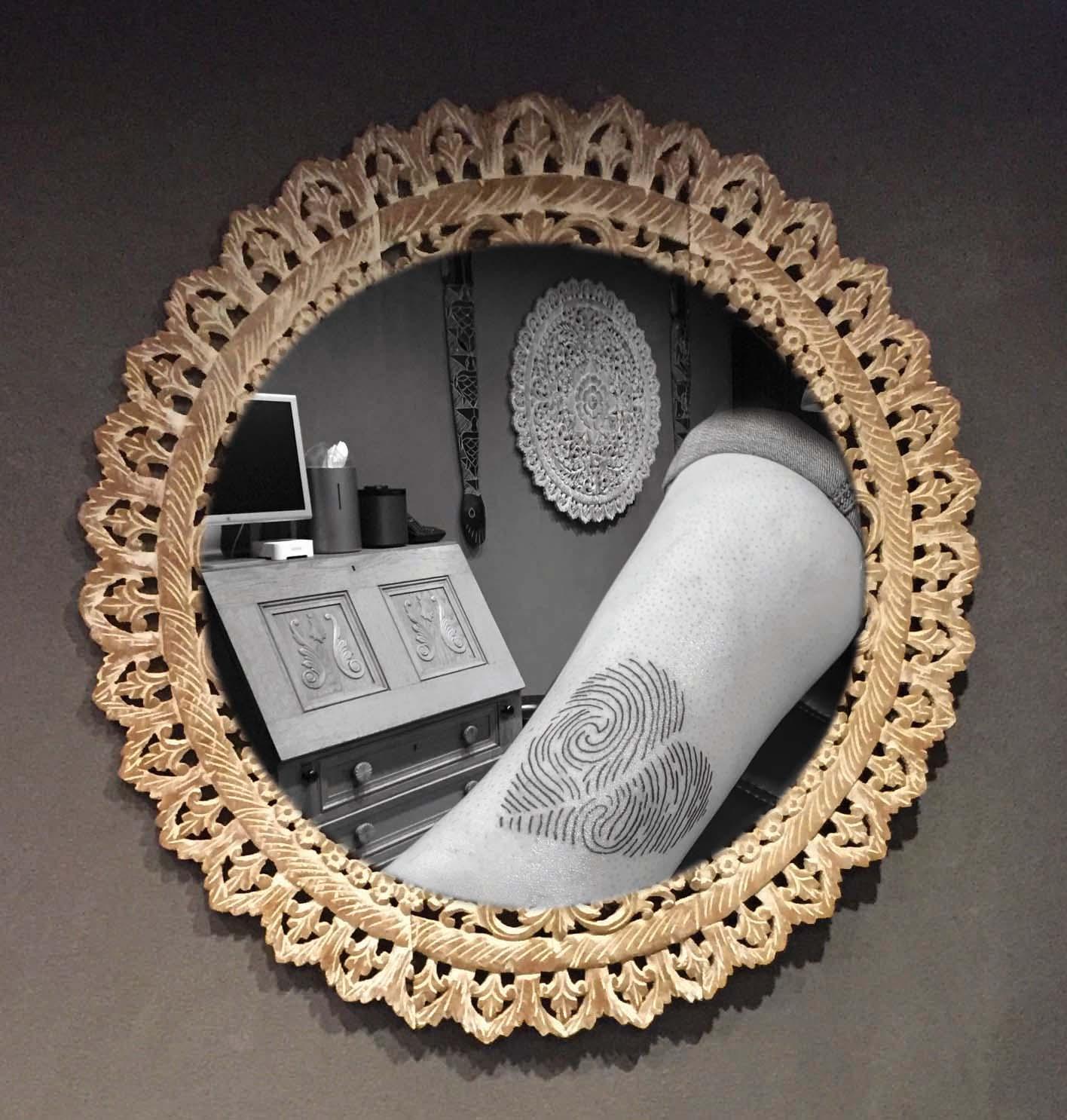 Vingerafdruk tatoeage op onderbeen