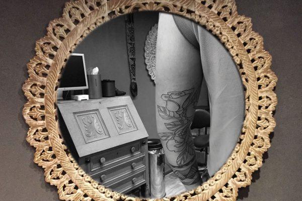 Rozen tatoeage op onderarm achterkant
