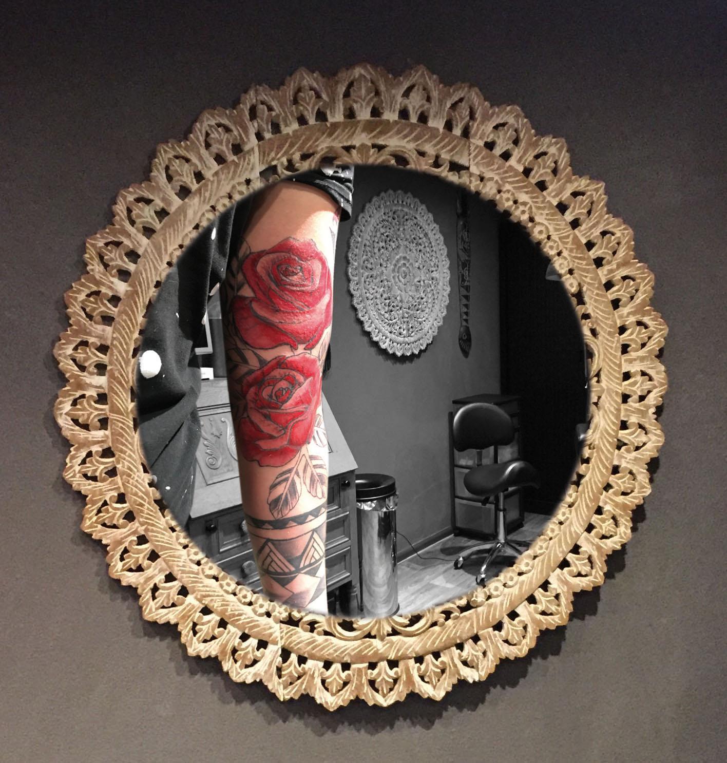Rozen tatoeage ingekleurd